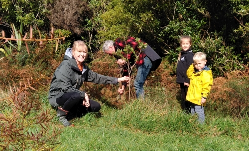 Photo of family planting trees during Conservation Week in the Remutaka Forest Park