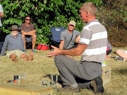 Mike White (Fixit) talking about predator trap maintenance issues at our Trust picnic/ BBQ.